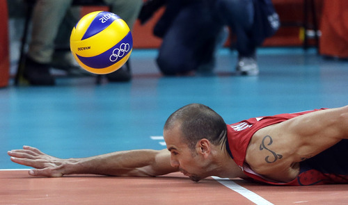 United States' Donald Suxho cannot reach a ball as it lands in for a point for Serbia during a men's preliminary volleyball match at the 2012 Summer Olympics, Sunday, July 29, 2012, in London. (AP Photo/Jeff Roberson)