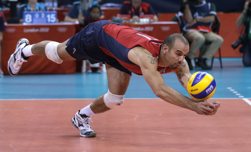 United States' Donald Suxho dives for a ball during a men's preliminary volleyball match against Serbia at the 2012 Summer Olympics, Sunday, July 29, 2012, in London. (AP Photo/Jeff Roberson)