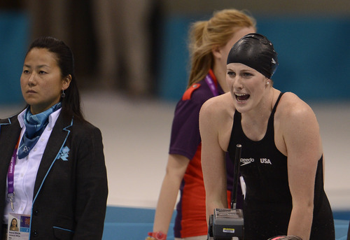 Missy Franklin cheers on her team  in the Women's 4 x 100m Freestyle Relay during the evening session of the swimming competition Saturday, July 28, 2012 at the Aquatics Centre. Missy swam the first leg of the relay.   John Leyba, The Denver Post