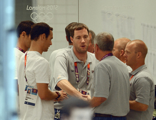 Missy Franlin's coach Todd Schmitz is congratulated in the hallway after the Women's 4 x 100m Freestyle Relay during the evening session of the swimming competition Saturday, July 28, 2012 at the Aquatics Centre.  The team raced to a Bronze Medal and the first for Missy Franklin. John Leyba, The Denver Post