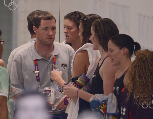 Missy Franlin's coach Todd Schmitz  gives a little look to Missy in teh hallway  after their win in the Women's 4 x 100m Freestyle Relay during the evening session of the swimming competition Saturday, July 28, 2012 at the Aquatics Centre.  The team raced to a Bronze Medal and the first for Missy Franklin. John Leyba, The Denver Post