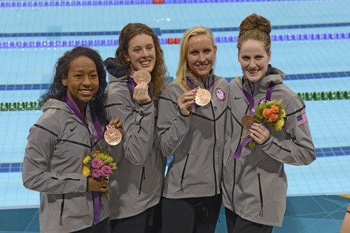 Lia Neal, Allison Schmitt and Jessica Hardy and Missy Franklin pose with their Bronze Medals after the Women's 4 x 100m Freestyle Relay during the evening session of the swimming competition Saturday, July 28, 2012 at the Aquatics Centre.  John Leyba, The Denver Post