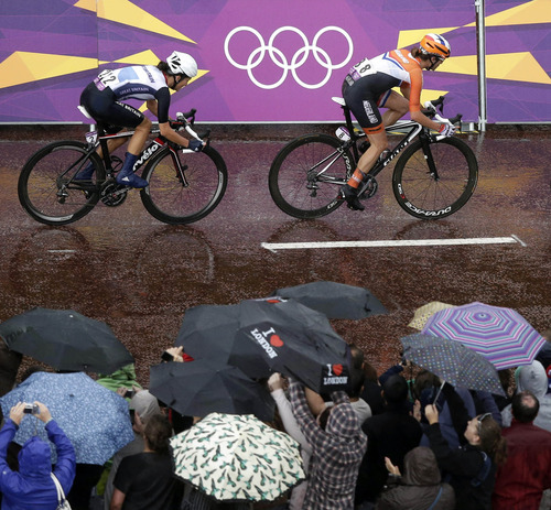 Marianne Vos, right, of The Netherlands, leads Elizabeth Armitstead, of Britain, into the final stretch of the women's road cycling race at the 2012 Summer Olympics on Sunday, July 29, 2012, in London. (AP Photo/Charlie Riedel, Pool)