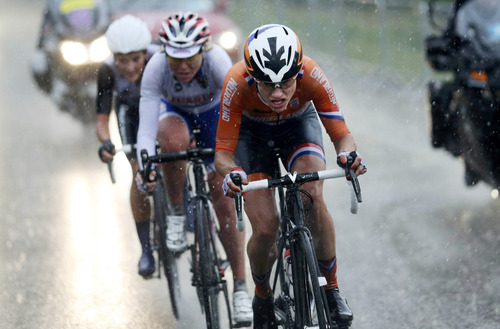 Netherlands' Marianne Vos competes in the women's cycling road race final at the 2012 Summer Olympics on Sunday, July 29, 2012, in London. (AP Photo/Stefano Rellandini, Pool)