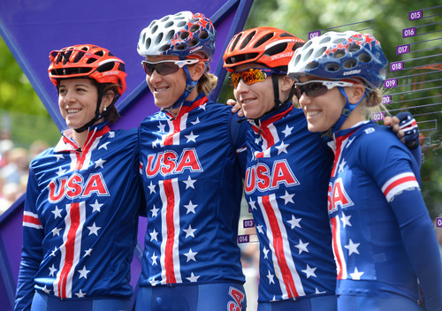From left to right USA's Evelyn Stevens, Kristin Armstrong, Amber Neben, and Shelley Olds pose for a picture before the Women's Road Race for the London 2012 Olympics in London, England on Sunday, July 29, 2012.  (Nhat V. Meyer/Mercury News)