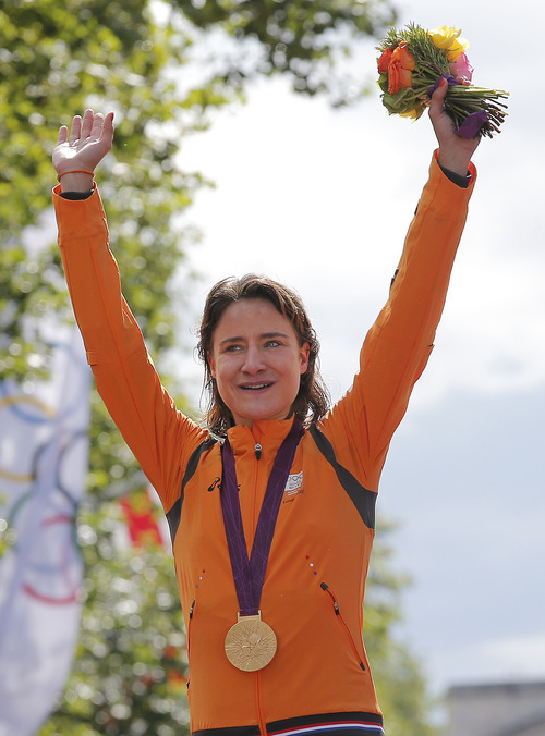 Marianne Vos, left, of The Netherlands, celebrates after winning the gold medal in the Women's Road Cycling race at the 2012 Summer Olympics, Sunday, July 29, 2012, in London. (AP Photo/Christophe Ena)