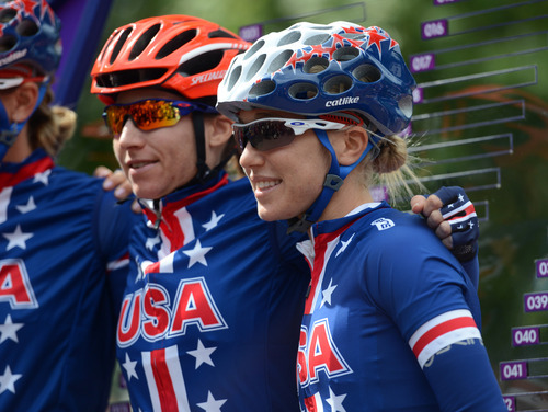 USA's Amber Neben, left, and Shelley Olds, right, pose for a picture before the Women's Road Race for the London 2012 Olympics in London, England on Sunday, July 29, 2012.  (Nhat V. Meyer/Mercury News)