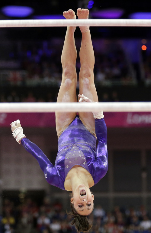 (AP Photo/Gregory Bull) U.S. gymnast Jordyn Wieber performs on the uneven barsduring the Artistic Gymnastics women's qualification at the 2012 Summer Olympics, Sunday, July 29, 2012, in London.