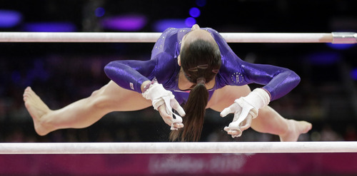 U.S. gymnast Jordyn Wieber performs on the uneven bars during the Artistic Gymnastics women's qualification at the 2012 Summer Olympics, Sunday, July 29, 2012, in London. (AP Photo/Gregory Bull)
