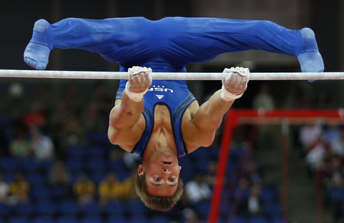 (AP Photo/Matt Dunham) U.S. gymnast Samuel Mikulak performs on the horizontal bar during the Artistic Gymnastics men's qualification at the 2012 Summer Olympics, Saturday, July 28, 2012, in London.