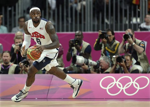 USA's Lebron James looks up the court during the first half of a preliminary men's basketball game against France at the 2012 Summer Olympics, Friday, July 27, 2012, in London. (AP Photo/Charles Krupa)