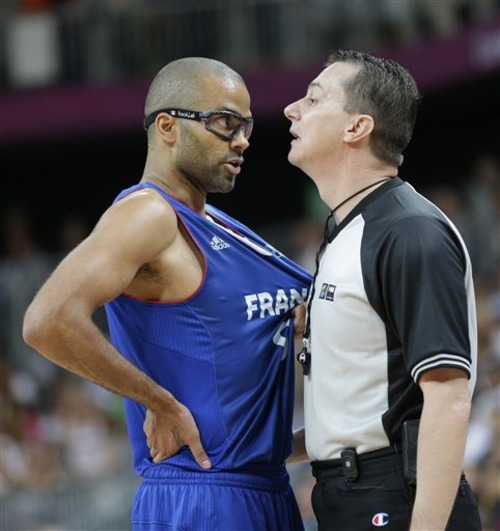 France's Tony Parker argues a call with an official during the first half of a preliminary men's basketball game against the USA at the 2012 Summer Olympics, Friday, July 27, 2012, in London. (AP Photo/Eric Gay)