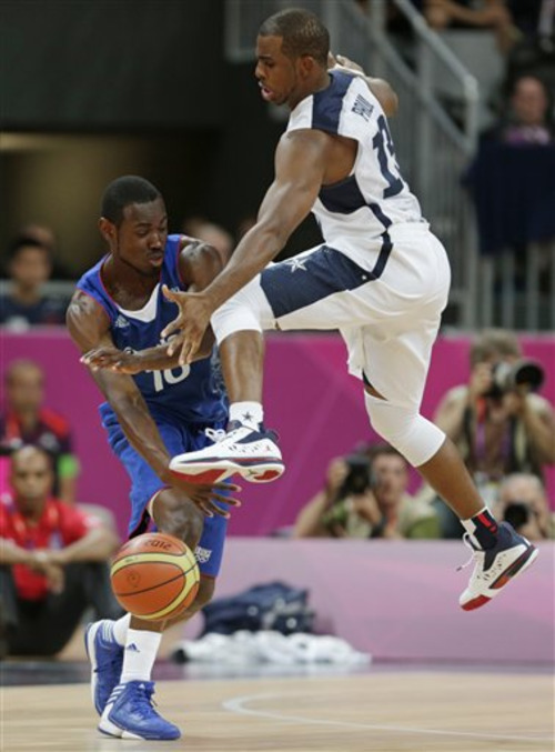 France's Yannick Bokolo is defended by USA's Chris Paul during the first half of a preliminary men's basketball game at the 2012 Summer Olympics, Friday, July 27, 2012, in London. (AP Photo/Charles Krupa)