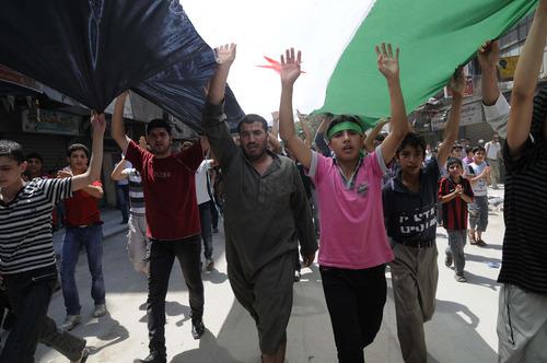 Syrians hold anti-government protest in Aleppo, Syria, Friday, July 27, 2012.   (AP Photo/Alberto Prieto)