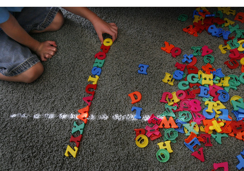Scott Sommerdorf  |  The Salt Lake Tribune              Six-year-old Logan Hilton, who is autistic, likes to meticulously lay out the alphabet backward, from Z to A in his Eagle Mountain home, Friday July 27, 2012. His mother, Michelle Hilton, qualifies for a new pilot program to treat Logan. The problem is she needs to contribute $6,000 to fully benefit.