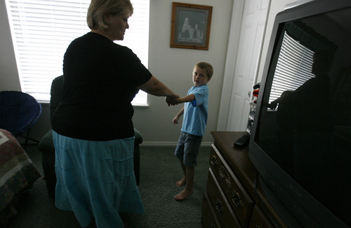 Scott Sommerdorf  |  The Salt Lake Tribune              Michelle Hilton is often led by the hand by her 6-year-old autistic son, Logan, so he can show her what he wants. Hilton qualifies for a new pilot program to treat Logan. The problem is she needs to contribute $6,000 to fully benefit.