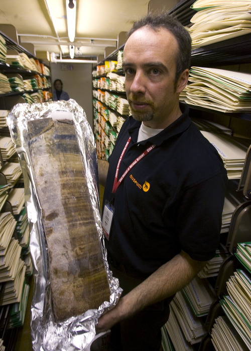 Mitchell Power, a geographer with the Natural History Museum of Utah , reconstructs fire regimes by studying the sediments recovered from lake beds. The charcoal in the core samples, like this frozen one from a Montana lake, gives important clues to the frequency and intensity of fires on surrounding terrain dating back centuries. Power coordinated a recent global study that concluded a cooling climate, not the depopulation of the Americas following the arrival of Columbus, triggered a reduction in fire after the 1400s.     Al Hartmann/Salt Lake Tribune     9/22/08