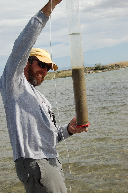 Mitchell Power, of the University of Utah and Natural History Museum of Utah, pulls a sediment core out of Spring Lake near Delta, Utah. The sediment core showed a reduction in charcoal – and thus fire – in the area during the Little Ice Age, a time of global cooling that began sometime between that A.D. 1200s and 1500s and ended in the early 1800s. A new study led by Powers suggests the Little Ice Age led to a worldwide reduction in fires after 1500, and that reduction was not caused by decimation of New Word populations by European diseases in the wake of Columbus. Courtesy University of Utah