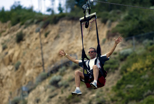 Kim Raff  |  The Salt Lake Tribune Chris Palme goes down the Extreme Zipline during the London Summer Olympics celebration at Utah Olympic Park in Park City, Utah on July 28, 2012.