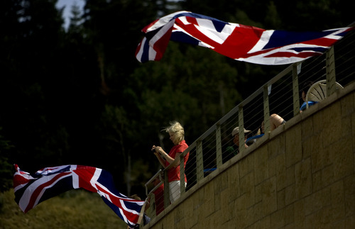 Kim Raff  |  The Salt Lake Tribune A woman watches ski jumpers practice during the London Summer Olympics celebration at Utah Olympic Park in Park City, Utah on July 28, 2012.