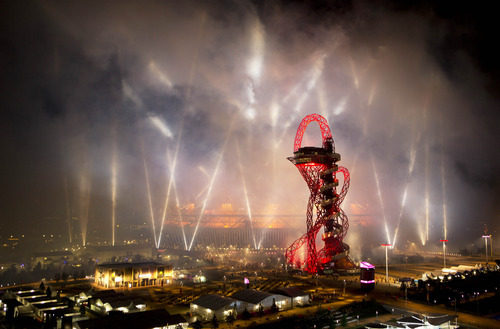 Fireworks light up the Olympic Stadium during the Opening Ceremony of the 2012 Summer Olympics, Saturday, July 28, 2012, in London. (AP Photo/Emilio Morenatti)