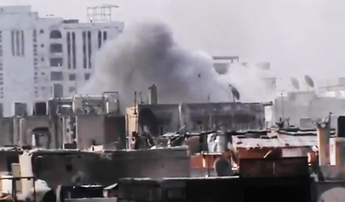 This image made from amateur video released by the Ugarit News and accessed Monday, July 30, 2012, purports to show smoke rising from buildings in Joret el-Shayah, Homs, Syria. (AP Photo/Ugarit News via AP video) THE ASSOCIATED PRESS IS UNABLE TO INDEPENDENTLY VERIFY THE AUTHENTICITY, CONTENT, LOCATION OR DATE OF THIS HANDOUT PHOTO