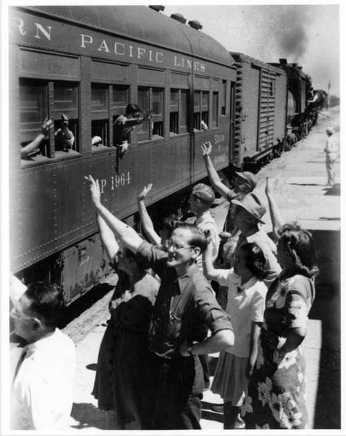 Crowd says goodbye to departees, one of the last trains to leave Delta.  Courtesy Topaz Collection, Utah State Historical Society.