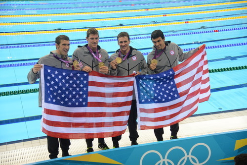 Michael Phelps, Conor Dwyer, Ryan Lochte, Ricky Berens celebrate their gold medal victory in the Men's 4 x 200m Freestyle Relay Tuesday, July 31, 2012, on Day 4 of the London 2012 Olympic Games.  (Karl Mondon/Contra Costa Times)