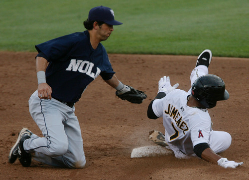 Steve Griffin | The Salt Lake Tribune   Zephyrs shortstop Gil Velazquez tags out Bees third baseman, Luis Jimenez, as he tries to steal second on a past ball during game between the Salt Lake Bees and the New Orleans Zephyrs at Spring Mobile Ballpark in Salt Lake City, Utah Wednesday August 1, 2012.