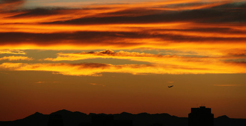 Steve Griffin | The Salt Lake Tribune   A jet takes off from the Salt Lake International airport as the western sky glows with color during the sunset in Salt Lake City, Utah Wednesday August 1, 2012.