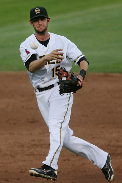 Steve Griffin | The Salt Lake Tribune   Bees second baseman Matt Long fires to first after scooping up a grounder during game between the Salt Lake Bees and the New Orleans Zephyrs at Spring Mobile Ballpark in Salt Lake City, Utah Wednesday August 1, 2012.