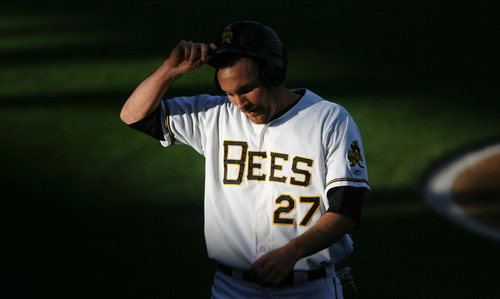 Steve Griffin | The Salt Lake Tribune   The evening light hits Bees outfielder Ryan Langerhans as he heads to the dugout between innings during game between the Salt Lake Bees and the New Orleans Zephyrs at Spring Mobile Ballpark in Salt Lake City, Utah Wednesday August 1, 2012.