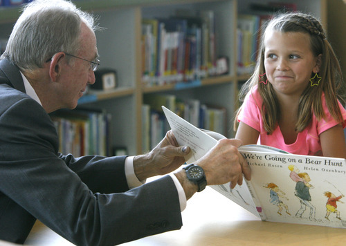 Rick Egan  | The Salt Lake Tribune   David Hardman reads to second Grader, Sydnee Hall at Foxboro Elementary, in North Salt Lake, Tuesday, July 31, 2012.  Gov. Herbert and leaders of Prosperity 2020 announced an initiative to get more business volunteers in schools.