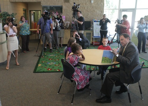 Rick Egan  | The Salt Lake Tribune   Gov. Herbert (left) reads to second grade students at Foxboro Elementary, in North Salt Lake, Tuesday, July 31, 2012.  Gov. Herbert and leaders of Prosperity 2020 announced an initiative to get more business volunteers in schools.