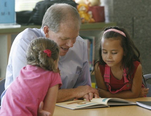 Rick Egan  | The Salt Lake Tribune   Jim Smith reads to second Graders, Kiana Turner (left) and Jordyn Felix, at Foxboro Elementary, in North Salt Lake, Tuesday, July 31, 2012.  Gov. Herbert and leaders of Prosperity 2020 announced an initiative to get more business volunteers in schools.
