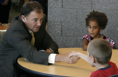 Rick Egan  | The Salt Lake Tribune   Gov. Herbert (left) shakes hands with Xavier Beebe, as Jessie De'Mzee looks on, before reading to the secod grade students at Foxboro Elementary, in North Salt Lake, Tuesday, July 31, 2012.  Gov. Herbert and leaders of Prosperity 2020 announced an initiative to get more business volunteers in schools.