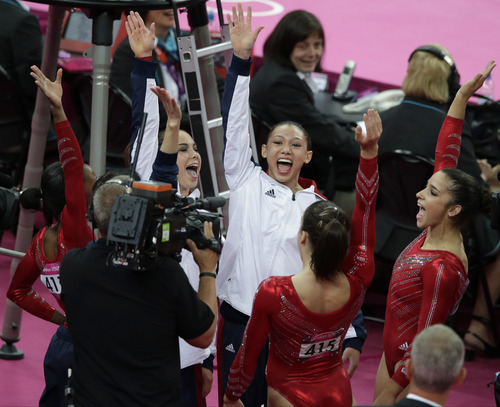 (AP Photo/Gregory Bull) U.S. gymnasts celebrate after being declared winners of the Artistic Gymnastic women's team final at the 2012 Summer Olympics, Tuesday, July 31, 2012, in London.