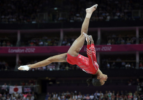 (AP Photo/Julie Jacobson) U.S. gymnast Gabrielle Douglas performs on the balance beam during the Artistic Gymnastics women's team final at the 2012 Summer Olympics, Tuesday, July 31, 2012, in London.