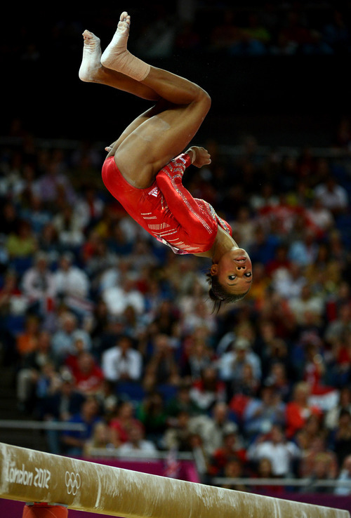 USA's Gabby Douglas competes on the balance beam for the Women's Gymnastics Team finals at North Greenwich Arena for the London 2012 Olympics in London, England on Tuesday, July 31, 2012.  (Nhat V. Meyer/Mercury News)