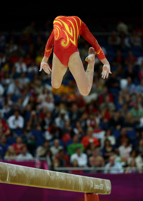 China's Qiushuang Huang competes on the balance beam for the Women's Gymnastics Team finals at North Greenwich Arena for the London 2012 Olympics in London, England on Tuesday, July 31, 2012.  (Nhat V. Meyer/Mercury News)