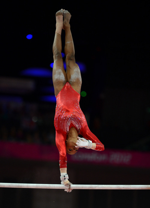 USA's Gabby Douglas competes in the uneven bars for the Women's Gymnastics Team finals at North Greenwich Arena for the London 2012 Olympics in London, England on Tuesday, July 31, 2012.  (Nhat V. Meyer/Mercury News)