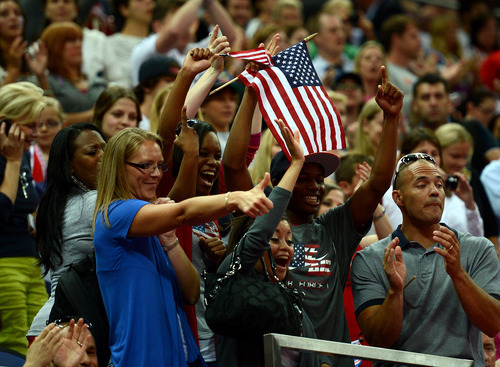 USA gymnastic fans cheer after the USA won the gold for the Women's Gymnastics Team finals at North Greenwich Arena for the London 2012 Olympics in London, England on Tuesday, July 31, 2012.  (Nhat V. Meyer/Mercury News)