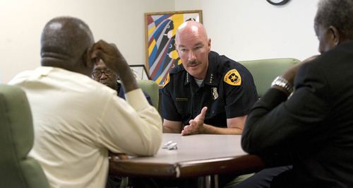 Paul Fraughton | Salt Lake Tribune Salt Lake City Chief of Police Chris Burbank meets with Rev France Davis of Calvary Baptist Church (back to camera)  to discuss  the circumstances leading to the death  of Allen Nelson who died while in police custody.  Present at the meeting at Calvary Baptist were Robert Comstock, James Green,to the right of Chief Burbank, Police Sgt. Fred Ross,  Rev Harold Fields and Rev. Nurjhan B. Govan.   Thursday, August 2, 2012