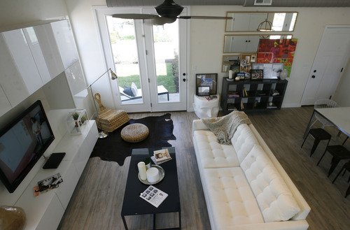 Scott Sommerdorf  |  The Salt Lake Tribune              Living room of the Daybreak Parade home. Advance of Salt Lake Parade of Homes, which begins Friday, August 3rd. Garbett Homes has one home in the parade this year in the Daybreak subdivision in South Jordan. It's priced at 236,000, is solar powered and has some other interesting features.