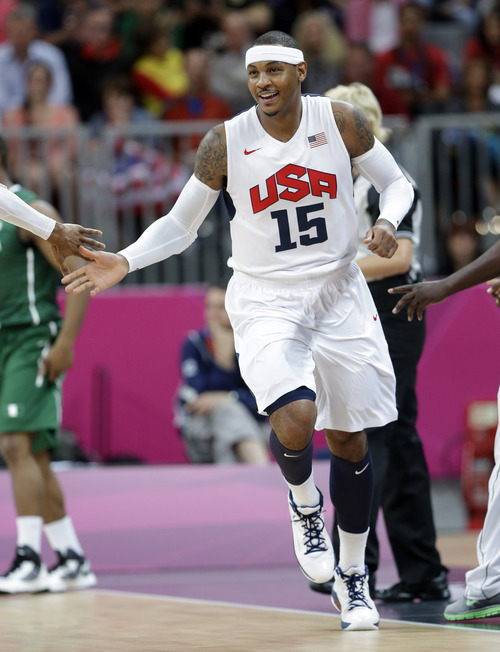 USA's Carmelo Anthony celebrates a score against Nigeria during a preliminary men's basketball game at the 2012 Summer Olympics, Thursday, Aug. 2, 2012, in London. (AP Photo/Eric Gay)