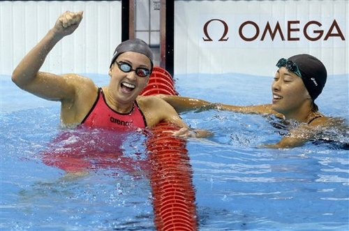 United States' Rebecca Soni, left, and Japan's Satomi Suzuki react after finishing first and second in the women's 200-meter breaststroke swimming final at the Aquatics Centre in the Olympic Park during the 2012 Summer Olympics in London, Thursday, Aug. 2, 2012. (AP Photo/Ben Curtis)