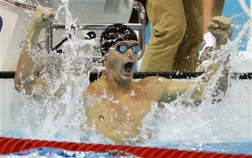 United States' Tyler Clary celebrates winning gold in the men's 200-meter backstroke swimming final at the Aquatics Centre in the Olympic Park during the 2012 Summer Olympics in London, Thursday, Aug. 2, 2012. (AP Photo/Michael Sohn)