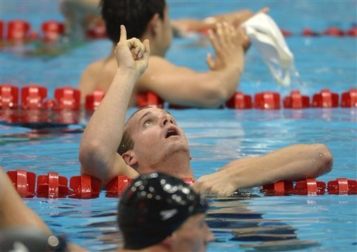 United States' Tyler Clary celebrates winning gold in the men's 200-meter backstroke swimming final at the Aquatics Centre in the Olympic Park during the 2012 Summer Olympics in London, Thursday, Aug. 2, 2012. (AP Photo/Mark J. Terrill)