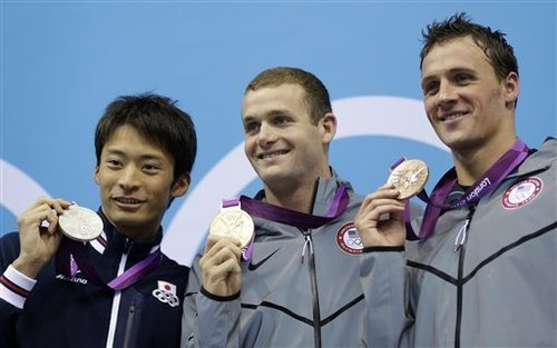 From left, Japan's Ryosuke Irie, United States' Tyler Clary and United States' Ryan Lochte pose with their medals for the men's 200-meter backstroke swimming final at the Aquatics Centre in the Olympic Park during the 2012 Summer Olympics in London, Thursday, Aug. 2, 2012. Clary won gold, Irie silver and Lochte bronze. (AP Photo/Michael Sohn)