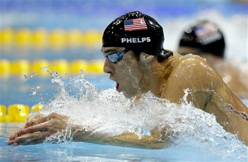 United States' Michael Phelps leads compatriot Ryan Lochte during the men's 200-meter individual medley swimming final at the Aquatics Centre in the Olympic Park during the 2012 Summer Olympics in London, Thursday, Aug. 2, 2012. (AP Photo/Matt Slocum)